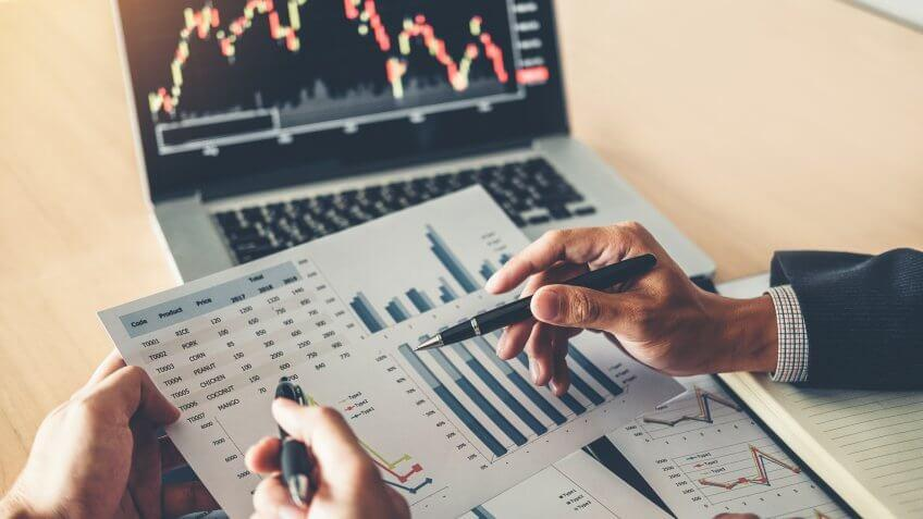 Business Team Investment Entrepreneur Trading discussing and analysis graph stock market trading,stock chart concept.