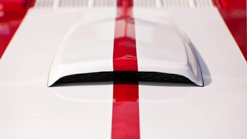 Hood of a muscle car close up.