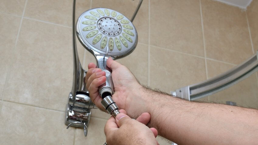 Installing a new shower hose on an used showerhead.