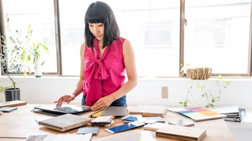 Female interior designer working in an architectural firm.