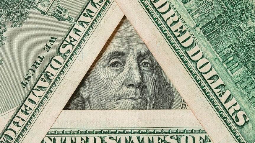 Triangle made of $100 banknotes with Benjamin Franklin portrait inside.