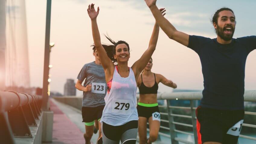 Runners running marathon in the city.