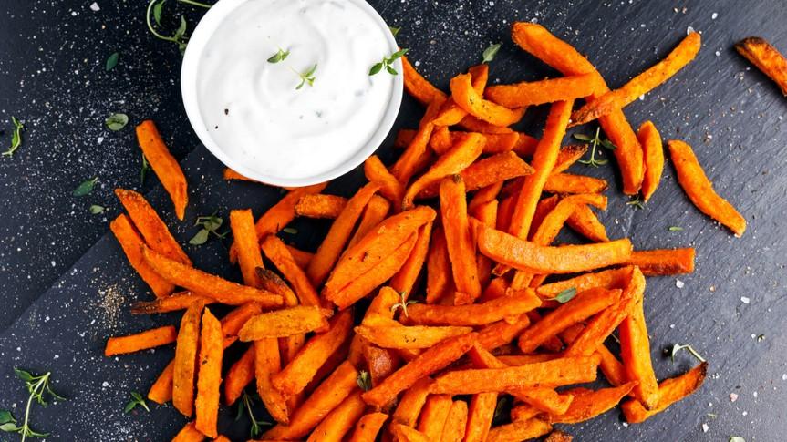 Healthy Homemade Baked Orange Sweet Potato Fries with fresh cream dip souce, herbs, salt and pepper.