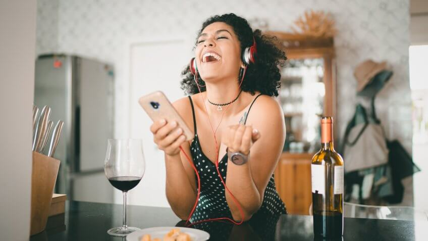 Woman Listening Music at Home.