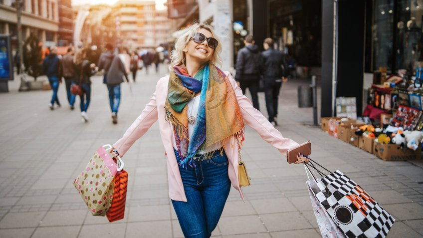 Happy young  woman in shopping.