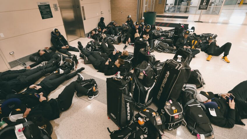 Mandatory Credit: Photo by Charles Rex Arbogast/AP/Shutterstock (10581406a)Players with the University of Missouri baseball team wait in the baggage claim area of Chicago's Midway Airport, only to arrive in Chicago and then get notified that the team's SEC Conference opener with Alabama Friday, had been canceledVirus Outbreak College Baseball, Chicago, United States - 12 Mar 2020.