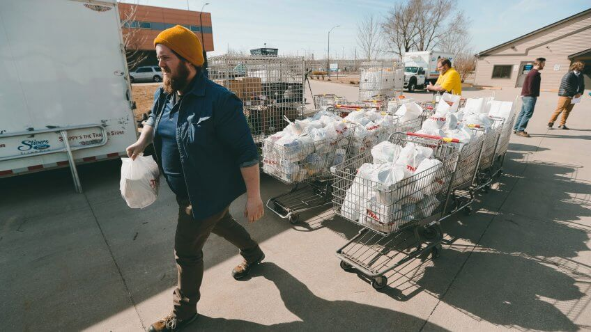 Mandatory Credit: Photo by Charlie Neibergall/AP/Shutterstock (10587213c)Patrick Minor loads food onto a delivery truck at the Des Moines Area Religious Council food pantry in Des Moines, Iowa.