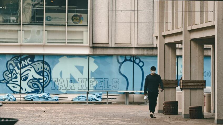 Mandatory Credit: Photo by Gerry Broome/AP/Shutterstock (10587388b)Pedestrian walks through campus at the University of North Carolina in Chapel Hill, N.