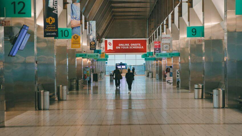 Mandatory Credit: Photo by Sue Ogrocki/AP/Shutterstock (10586634a)Passengers walk through a nearly empty concourse at Will Rogers World Airport in Oklahoma City, as airlines limit flights due to the virus outbreakVirus Outbreak Oklahoma Airports, Oklahoma City, United States - 17 Mar 2020.