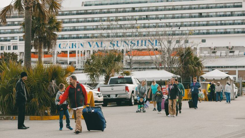 Mandatory Credit: Photo by Mic Smith/AP/Shutterstock (10584695f)Passengers disembark from the Carnival Sunshine cruise ship, in Charleston, S.