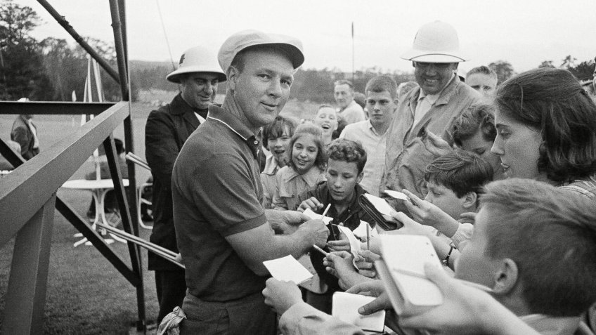 Arnold Palmer obliges the kids with autographs following practice round for the Masters Golf Tournament in Augusta, Ga.