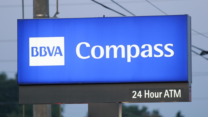 Huntsville, Alabama, USA - August 3, 2011: Close up of illuminated BBVA Compass sign at sunrise.