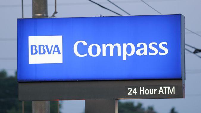 Huntsville, Alabama, USA - August 3, 2011: Close up of illuminated BBVA Compass sign at sunrise.
