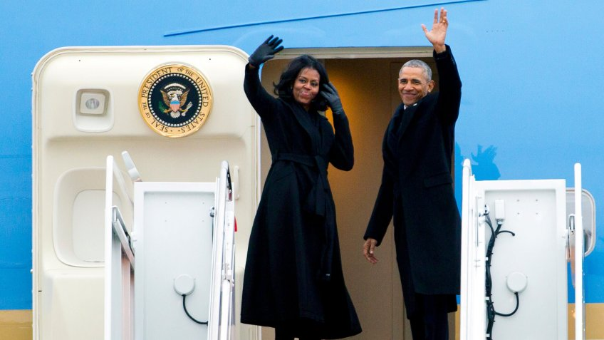 Barack Obama, Michelle Obama President Barack Obama and first lady Michelle Obama wave from Air Force One at Andrews Air Force Base, Md.