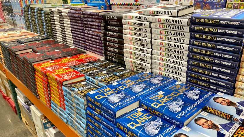 San Jose, CA - December 6, 2019: Stacks of hard cover books at Costco including titles by authors like Janet Evanovich, Tom Clancy and Donald Trump Jr.