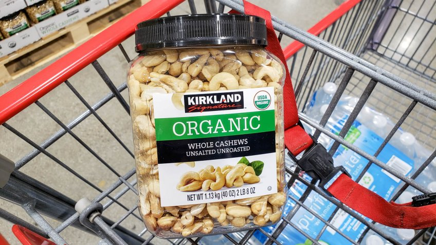 Alhambra, California/United States - 01/31/2020: A view of a container of Kirkland Signature organic whole cashews on display inside a shopping cart, in a local Costco.