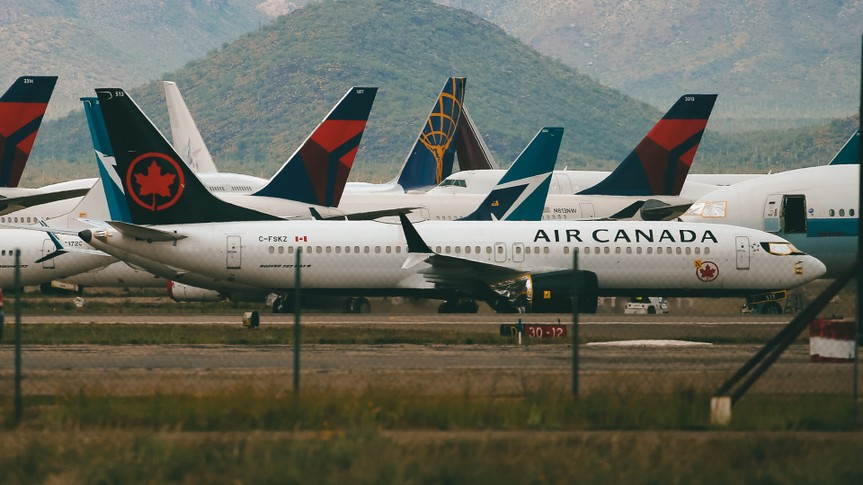 Recently landed passenger planes are parked at Pinal Airpark, in Red Rock, Ariz.