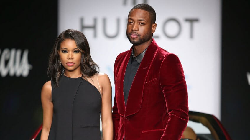 "Mandatory Credit: Photo by Omar Vega/Invision/AP/Shutterstock (9135196e)Gabrielle Union and Dwyane Wade pose on the runway during the 3rd Annual ""A Night on the RunWade"" benefiting Wade's World Foundation at Ice Palace Studios on in Miami, FL3rd Annual ""A Night on the RunWade"", Miami, USA."