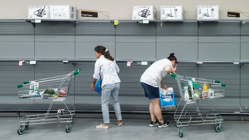 Gold Coast, Australia - March 9, 2020: Supermarket empty toilet paper shelves amid coronavirus fears, shoppers panic buying and stockpiling toilet paper preparing for a pandemic.