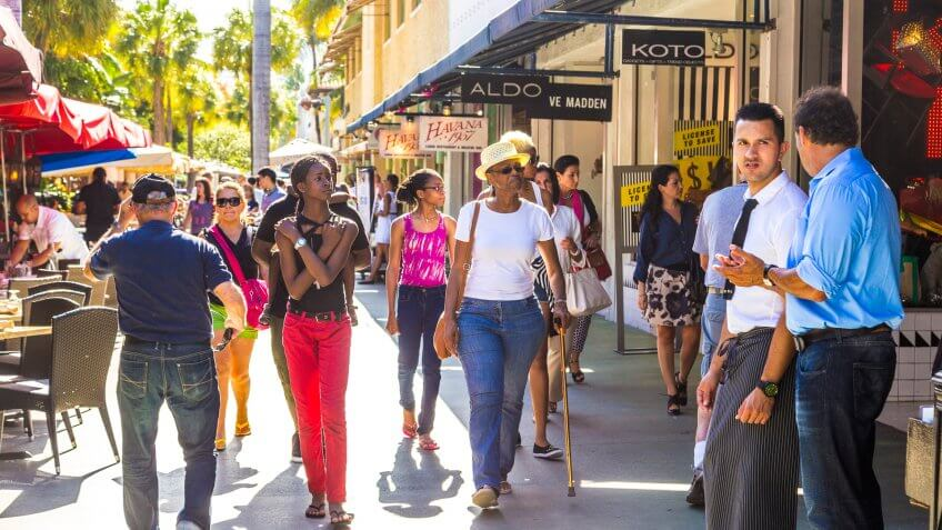 Miami, USA - August 1, 2013: people go shopping in the afternoon sun in Lincoln Road, Miami, USA.