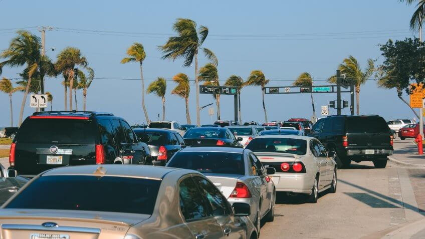 Fort Lauderdale, Florida, USA - March 23, 2013: Intersection at Sunrise Boulevard and State Road A1A near the beach during the day with many vehicles waiting for the traffic signal during spring break.