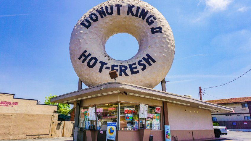 Gardena, California USA - June 27 2019: Donut King II is a survivor of a chain of Big Donut shops in Los Angeles featuring huge iconic donut symbols.