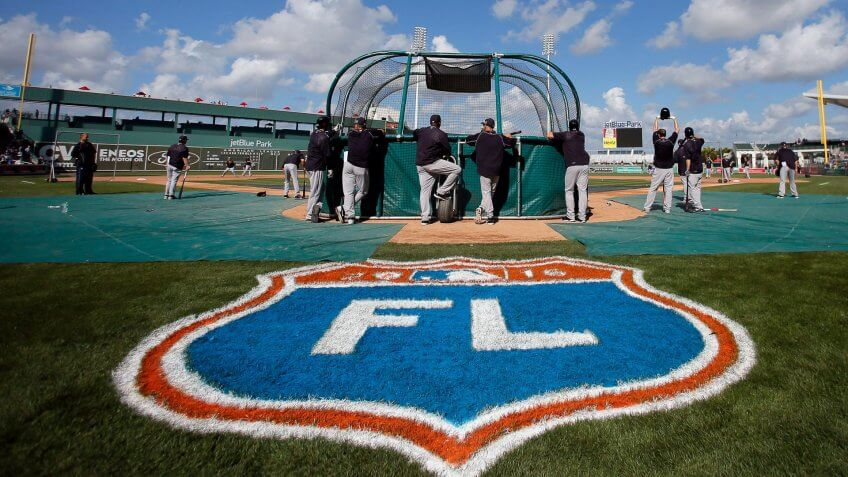 The Cactus League logo is shown at front as the New York Yankees take batting practice before a spring training baseball game against the Boston Red Sox, in Fort Myers, FlaYankees Red Sox Baseball, Fort Myers, USA.