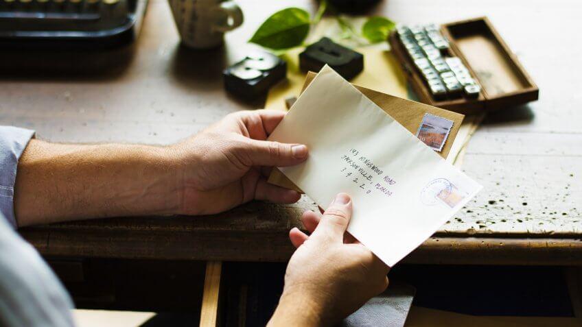 People Hands Holding Envelope Letter Communication.