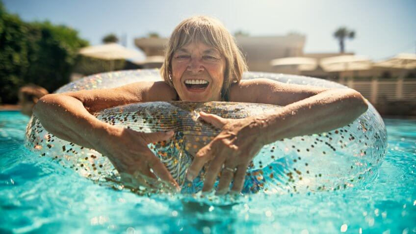 Happy senior woman enjoying summer vacations.