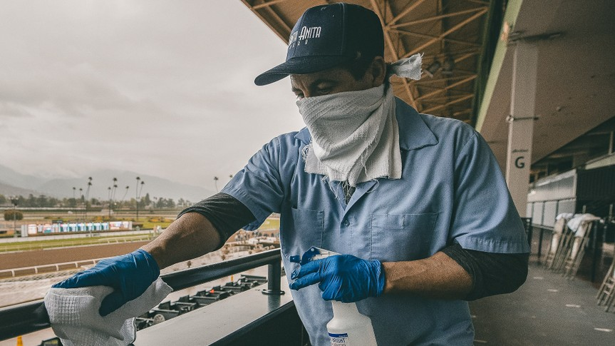 An unidentified worker sanitizes the grandstand handrails despite being closed to the public for safety concerns over the coronavirus in Arcadia, California on Evers/Eclipse Sportswire/CSMHorse Racing Horse Racing continues despite COVID19, Arcadia, USA - 14 Mar 2020.