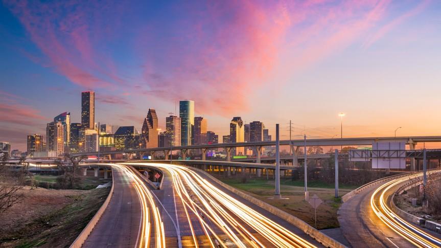 Houston, Texas, USA downtown skyline over the highways at dusk.
