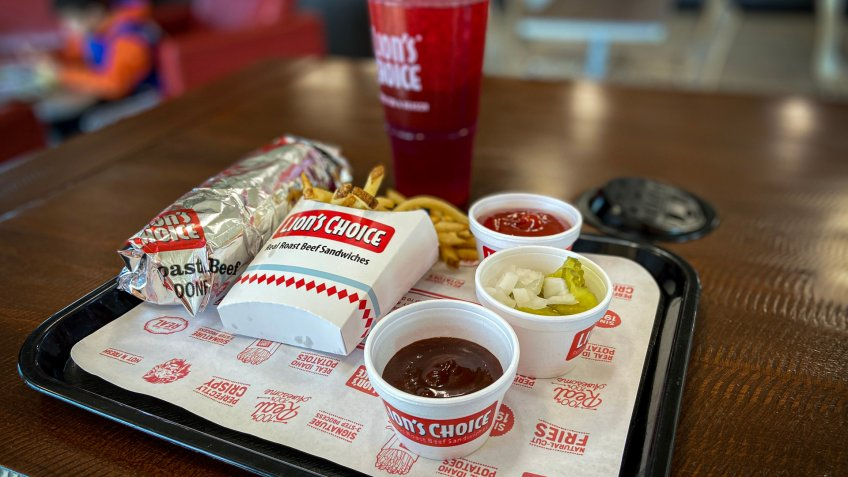 O'Fallon, Illinois—Nov 16, 2019; Italian Roast Beef sandwich meal sitting on tray with condiments; Lions Choice is a Saint Louis, Missouri regional fast food restaurant chain established in 1967.