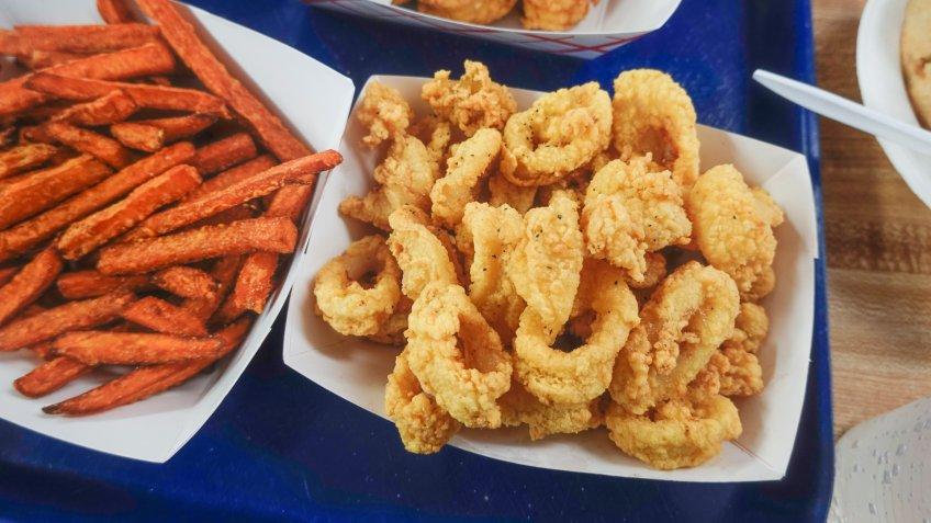 Ipswich, Massachusetts, USA A tray of sweet potato fries and calamari.
