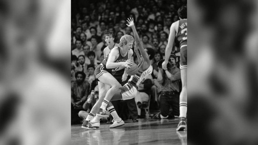 Boston's Larry Bird knocks over Milwaukee Junior Bridgeman as he heads for the basket during National Basketball Association Playoff Action, Monday night, in Milwaukee.