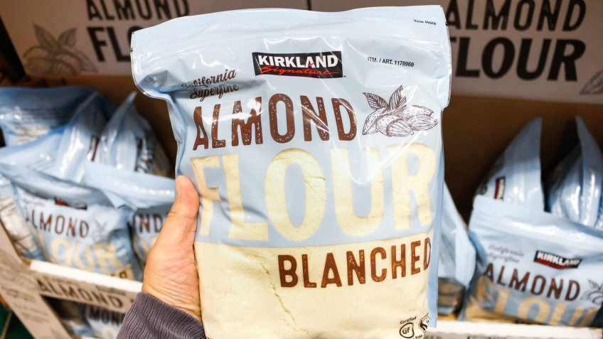 Garden Grove, California/United States - 02/13/2020: A hand holds a package of Kirkland Signature Almond Flour on display at a local Costco.