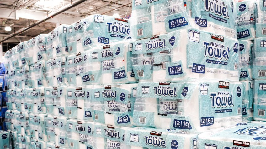 Tustin, California/United States - 02/08/2020: A view of several cases of Kirkland Signature Premium Towel paper towels on display at a local Costco.