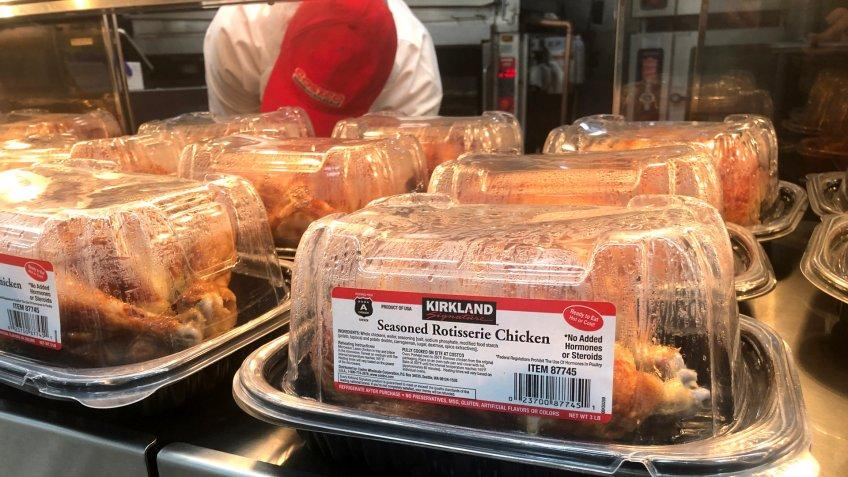 Los Angeles, CA/USA 11/25/2019 Kirkland brand seasoned rotisserie chickens for sale at a Costco Mega Discount Store.