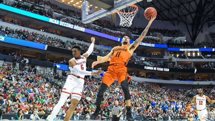 Florida Gators guard Chris Chiozza #11 with a lay up in the first half in the second round of the NCAA March Madness Men's Basketball game between the Texas Tech Red Raiders and the Florida Gators at the American Airlines Center in Dallas, TX Albert Pena/CSMNCAA March Madness Basketball Texas Tech vs Florida, Dallas, USA - 16 Mar 2018.