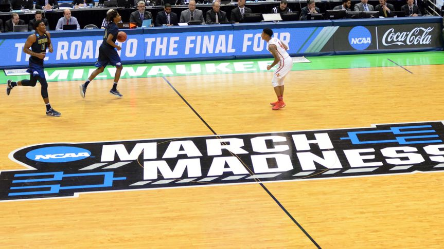 March Madness logo on basketball court