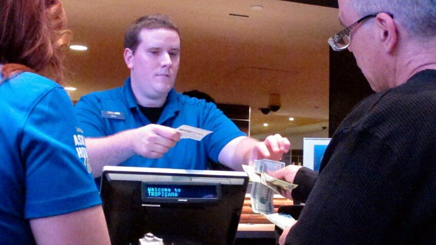 In this March 8, 2019 photo, a gambler makes a sports bet at the Tropicana casino in Atlantic City N.