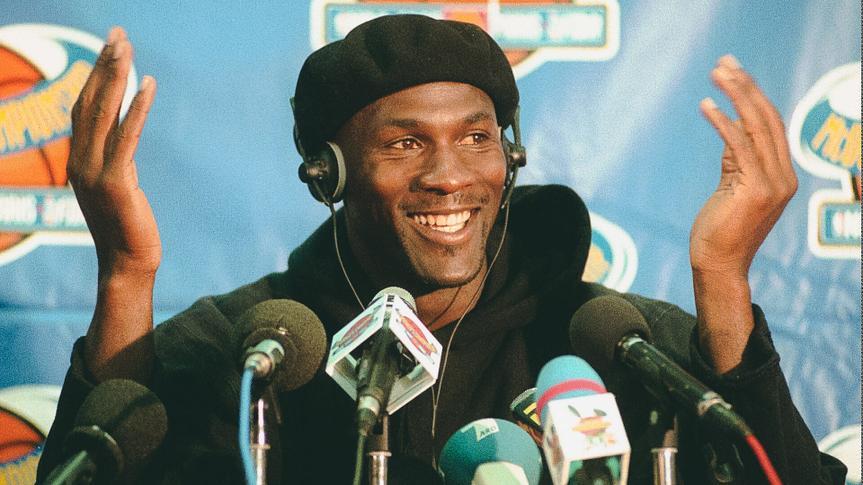 JORDAN FILES -Chicago Bulls player Michael Jordan gestures during a news conference at Bercy stadium in Paris .