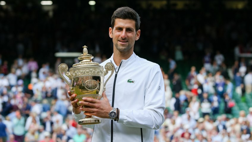 Mandatory Credit: Photo by Aflo/Shutterstock (10334442d)Novak Djokovic of Serbia poses with the trophy after winning the men's singles final match against Roger Federer of SwitzerlandWimbledon Tennis Championships, London, UK - 14 Jul 2019.