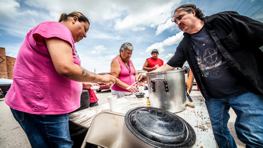 Oglala, USA - July 1, 2014: Indians selling and buying traditional soup called Menudo in Pine Ridge Indians Reservation, South Dakota.