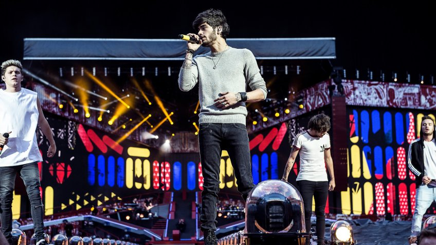 Anglo-Irish pop boy band One Direction perform during their 'Where We Are Tour 2014' at Parken Stadium in Copenhagen, Denmark .