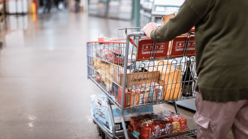 Tigard, Oregon - Nov 8, 2019 : People with carts in Costco Wholesale.