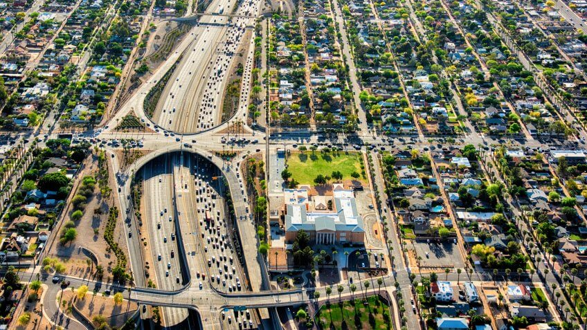 An aerial view of a Phoenix, Arizona freeway during rush hour shot from an altitude of about 1500 feet during a helicopter photo flight using a wide angle lens.