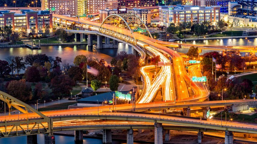 Pittsburgh traffic trails on the highway junction between Fort Duquesne and Fort Pitt bridges.