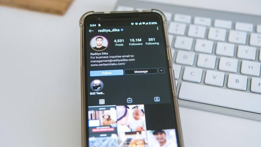 Raditya Dika on Instagram app smartphone GOBankingRates