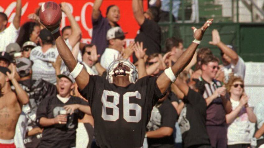 "Mandatory Credit: Photo by Paul Sakuma/AP/Shutterstock (6511433c)ISMAIL Oakland Raiders Raghib ""Rocket"" Ismail raises his arms in the end zone after catching a 44-yard pass for a touchdown in the fourth quarter against the Indianapolis Colts, at the Coliseum in Oakland, Calif."