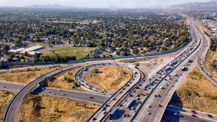 Sweeping drone view from above of the busy streets and freeways in and around Salt Lake City.